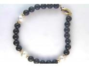 Lady's 14k Yellow Gold Freshwater Cultured Pearl And Black Onyx Bracelet